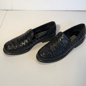 Cole Haan black slip on casual shoes.  Size 9B